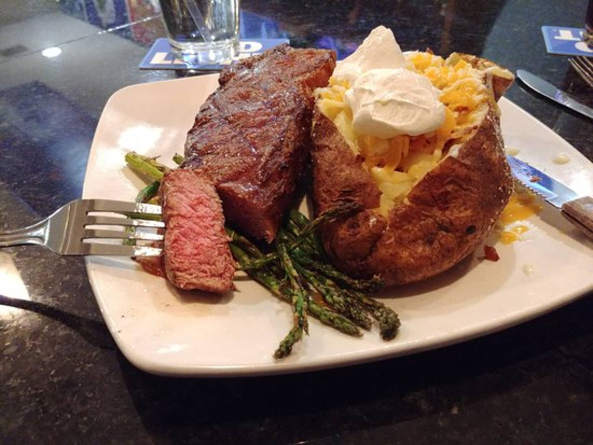Grilled Steak with Loaded Baked Potato